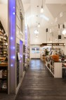 Ada's Technical Books & Café central aisle. – Ada's Technical Books & Café – Retail Design – Board & Vellum