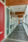 Capital Pacific – Commercial Office Design – Entrance off a covered outdoor walkway.