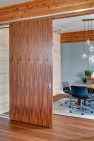 Capital Pacific – Commercial Office Design – Sliding wood panels.