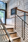 Oasis Tea Zone Capitol Hill – Metal railing with wood cap on stairs. – Retail Café Design
