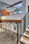 Oasis Tea Zone Capitol Hill – Stool seating at the lower level. – Retail Café Design