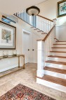 Entry at ground level with stair up to main level. – Gut and Remodel of a 1960s-era Home – Sound Landing – Board & Vellum