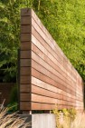 Fence with horizontal wood planks wrapping corner. – Urban Yard at The Seattle Box – Board & Vellum