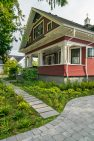 A classic Craftsman home with a large front porch with columns.